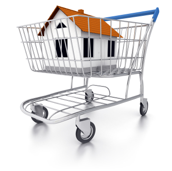 Shopping cart containing house. Digitally Generated Image isolated on white background